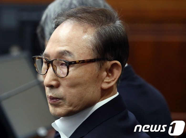 "MB 불출석 재판 공전…""위법"" vs"