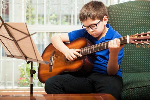 depositphotos_67248331-stock-photo-kid-practicing-some-guitar-chords.jpg